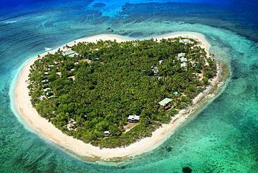 Aerial view of the heart-shaped island of Tavarua, near Viti Levu, Republic of Fiji, South Pacific Islands, Pacific