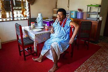 Old Woman inside a house in Solevu island and Yaro island in Malolo Island Mamanucas island group Fiji