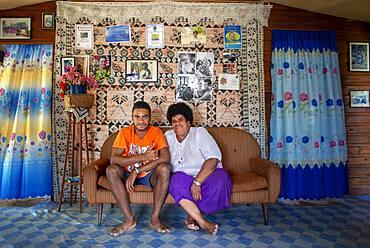 Family inside a house in Solevu island and Yaro island in Malolo Island Mamanucas island group Fiji