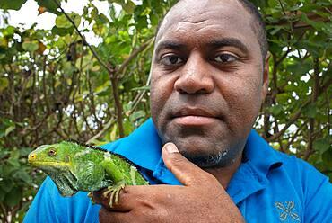 Person who takes care of Endangered Fiji crested iguana (Brachylophus vitiensis) Fiji banded iguana (Brachylophus fasciatus) at Malolo Island Mamanucas island group Fiji
