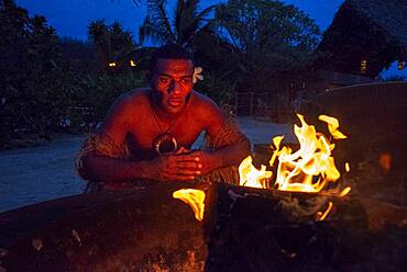 Likuliku Lagoon Resort, Five Star Resort, Malolo Island, Mamanucas, Fiji.  Lighting fire late in the afternoon.