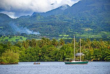 Old sailing boat in front of Tahitian coast.  Papeete Tahiti nui French Polynesia France