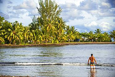 Beach in in front of Tahitian coast.  Papeete Tahiti nui French Polynesia France