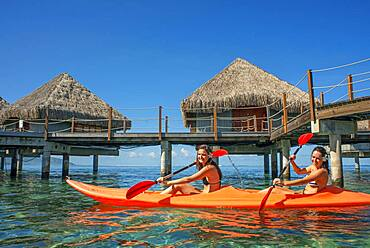 Kayaking in front Le Meridien Hotel on the island of Tahiti, French Polynesia, Tahiti Nui, Society Islands, French Polynesia, South Pacific.