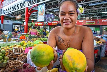 Woman fruit seller at Papeete Municipal covered Market, Papeete, Tahiti, French Polynesia, Tahiti Nui, Society Islands, French Polynesia, South Pacific.