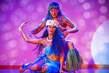 Dancing show of polynesian dances on Paul Gauguin cruise ship. France, French Polynesia, Polynesian, South Pacific.