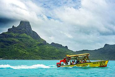 An outrigger boat used for reef excursions in Bora Bora, French Polynesia Society Island.