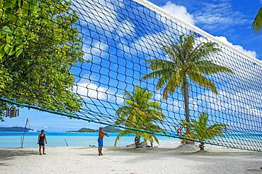 Volley in th beach of motu Tevairoa island, a little islet in the lagoon of Bora Bora, Society Islands, French Polynesia, South Pacific.