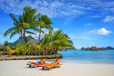 Beach in Le Bora Bora by Pearl Resorts luxury resort in motu Tevairoa island, a little islet in the lagoon of Bora Bora, Society Islands, French Polynesia, South Pacific.