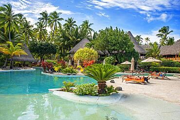 Pool of Le Bora Bora by Pearl Resorts luxury resort in motu Tevairoa island, a little islet in the lagoon of Bora Bora, Society Islands, French Polynesia, South Pacific.