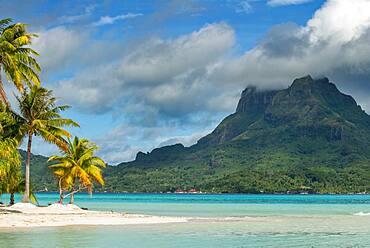 Beach of motu Tevairoa island, a little islet in the lagoon of Bora Bora, Society Islands, French Polynesia, South Pacific.