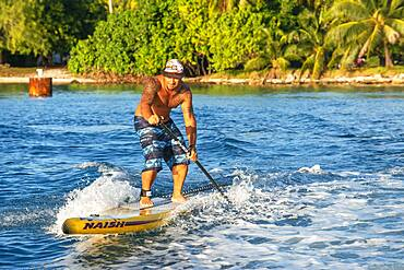 Paddle surf in the beach of Rangiroa, Tuamotu Islands, French Polynesia, South Pacific.