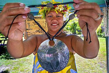 Local woman selling crafs in Fakarava, Tuamotus Archipelago French Polynesia, Tuamotu Islands, South Pacific.