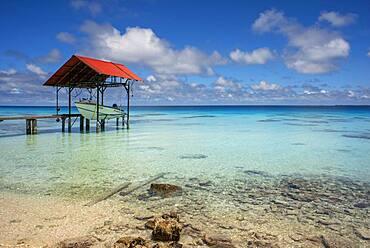 Small pier and boat in Fakarava, Tuamotus Archipelago French Polynesia, Tuamotu Islands, South Pacific.