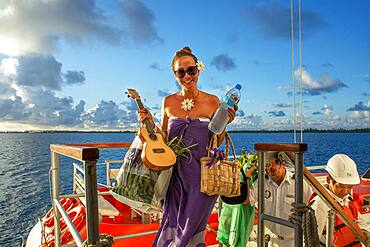 Paul Gauguin cruise staff anchored in Fakarava, Tuamotus Archipelago French Polynesia, Tuamotu Islands, South Pacific.
