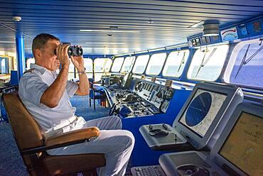 Captain of Paul Gauguin cruise, French Polynesia, Tuamotus Archipelago, Society Islands, South Pacific.