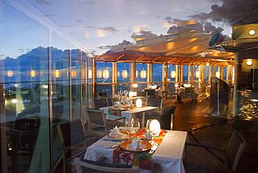 Restaurant in the luxury Paul Gauguin cruise, Society Islands, Tuamotus Archipelago, French Polynesia, South Pacific.