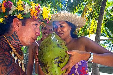 Drinking coconut milk in Fakarava,  Tuamotus Archipelago French Polynesia, Tuamotu Islands, South Pacific.
