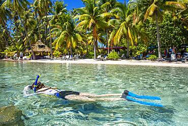 Island of Taha'a, French Polynesia. A tourist girl do dive at the Motu Mahana, Taha'a, Society Islands, French Polynesia, South Pacific.