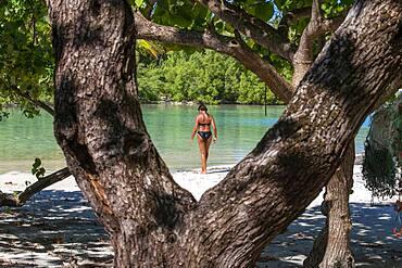 Island of Taha'a, French Polynesia. Motu Mahana woman at the beach, Taha'a, Society Islands, French Polynesia, South Pacific.