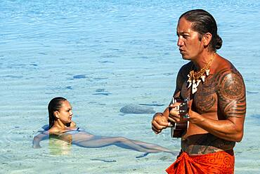 Island of Taha'a, French Polynesia. A local boy plays the ukulele to woo your girl at the Motu Mahana, Taha'a, Society Islands, French Polynesia, South Pacific.