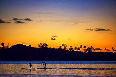 Rowing at sunset in Tahiti, French Polynesia, Tahiti Nui, Society Islands, French Polynesia, South Pacific.