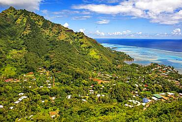 Typical houses, road, and reef see, Moorea island (aerial view), Windward Islands, Society Islands, French Polynesia, Pacific Ocean.