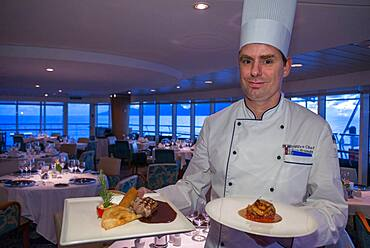 Stefan Berndt, the executive chef of Paul Gauguin show some dishes of the restaurant, 2-star Michelin. Paul Gauguin cruise, Society Islands, Tuamotus Archipelago, French Polynesia, South Pacific.