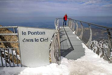 View point of The Observatory Of Pic Du Midi De Bigorre, Hautes Pyrenees, Midi Pyrenees, France. The 12m Ponton dans le ciel, a glass walkway high above the Pyrenees at Pic du Midi de Bigorre, a 2877m mountain in the French Pyrenees, home to an astronomical observatory and visitors centre. The observatory is acccessible from the village of La Mongie by cablecar. Tourists often visit in time for the spectacular sunset across the mountains.