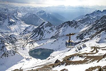 La Mongie lake of Oncet and a cable car rising to The Observatory Of Pic Du Midi De Bigorre, Hautes Pyrenees, Midi Pyrenees, France