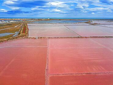 Salt production of Salins du Midi at  Gruissan in Languedoc-Roussillon, France, Aude, Gruissan. Solar evaporaton salt pans salins. salt marshes, saline of Gruissan in aerial view.