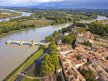 Aerial view of Avignon Bridge with Popes Palace and Rhone River at sunrise, Pont Saint-Benezet, Provence, France