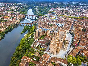 Gothic Saint Cecile Cathedral in Albi town. Pont Vieux bridge and the Church of Notre Dame du Breuil in Tarn village, Languedoc-Roussillon Occitanie Midi Pyrenees France.