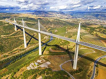 Aerial view Millau viaduct by architect Norman Foster, between Causse du Larzac and Causse de Sauveterre above Tarn, Aveyron, France. Cable-stayed bridge spanning the Tarn River Valley. A75 motorway, built by Michel Virlogeux and Norman Foster, located between Causses de Sauveterre and Causses du Larzac above Tarn River, Natural Regional Park of Grands Causses.