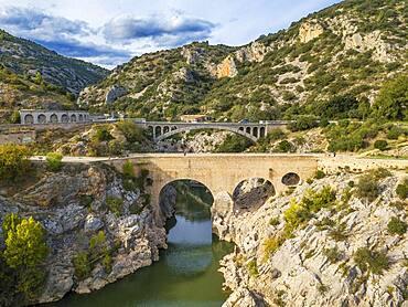 Pont du Diable, the Devil's Bridge, over Hérault River, near Saint Guilhem le Désert, Hérault, Languedoc Roussillon. Saint Jean de Fos, the Pont du Diable over the Herault river on the Routes of Santiago de Compostela, listed as World Heritage by UNESCO, Herault, France.