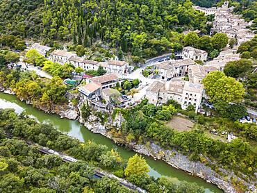 Aerial view Saint Guilhem le Desert, labelled Les Plus Beaux Villages de France (The Most Beautiful Villages of France), a stop on el Camino de Santiago, Herault, France.