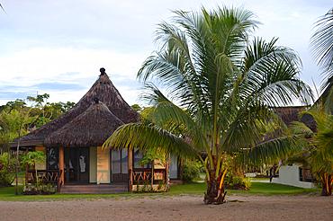 """Beachfront resort bangalow, or """"bure"""", Pacific Harbour, Viti Levu, Fiji"""