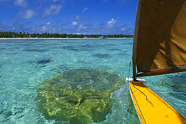 Riding a traditional outrigger canoe, Ailuk atoll, Marshall Islands, Pacific