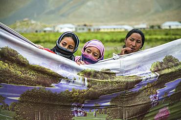 Guests during a Tibetan wedding in Zanskar Valley, Northern India.