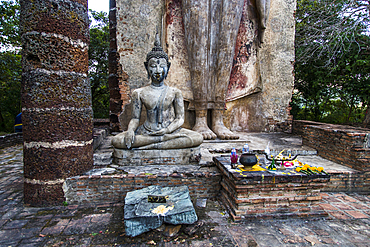 Archaeological site, ruins and Buddha statue in Sukhotai