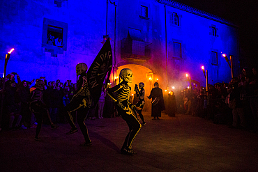 Verges, a small town in the Northeast of Catalonia (Spain), during Easter celebrates the Procession of Verges with skeletons dancing on the sound of a drum, Roman soldiers, known as the 'Manages', and a representation of the life and crucifixion of Jesus Christ. The Procession features the Dance of Death, a tradition from the Middle Age associated with epidemics and plagues and the only one remaining in Spain Ten skeletons dance to the beat of a drum to remember that no one is exempt of death. The backdrop of the medieval walls and towers of Verges is key to this macabre staging.