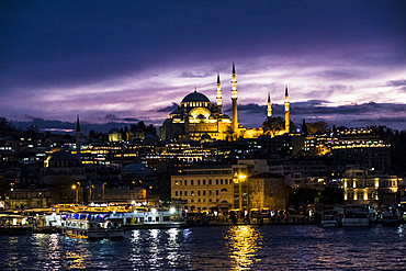 Rüstem Pasha mosque and the Golden Horn seen from Galata Bridge after sunset