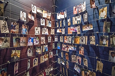 Photographs of known victims of the 1994 Rwandan Genocide line the walls of the Kigali Genocide Memorial, Kigali, Rwanda.