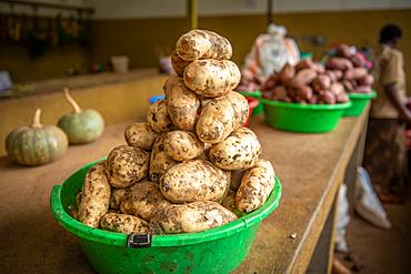 Potatoes stacked in plastic bin at outdoor market, Rwanda Farmers Market, in Rwanda