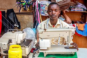 Man with sewing machine Kimironko Market, Kigali Rwanda