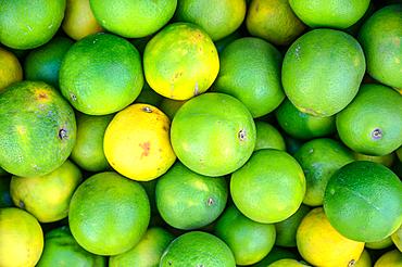 Close up on pile of limes, Debre Berhan, Ethiopia