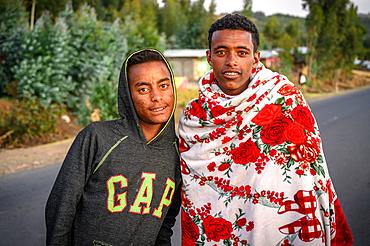 A pair of young Ethiopian men pose for a photograph, Debre Berhan, Ethiopia