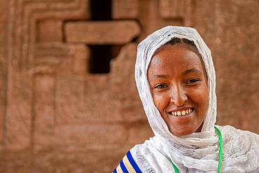 Portrait of an Ethiopian woman outside of the rock hewn monolithic church of Bet Maryam (Church of St. Mary) in Lalibela, Ethiopia