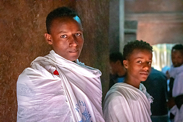 A pair of young men in shawls inside of Bet Giyorgis (Church of St. George) in Lalibela, Ethiopia