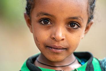 Portrait of a young Ethiopian schoolgirl, Lalibela, Ethiopia.